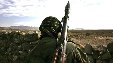 An Afghan National Army soldier looks towards the Pakistani border.