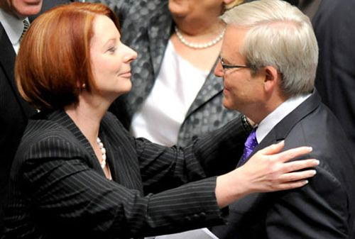 Julia Gillard greets Kevin Rudd in parliament.