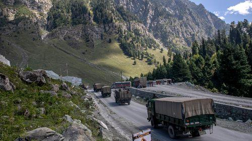 An Indian army convoy moves on the Srinagar- Ladakh highway at Gagangeer, northeast of Srinagar.