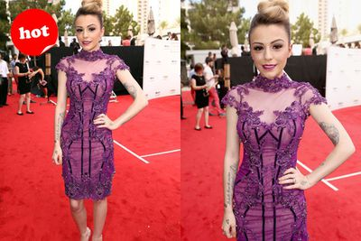 Although it's a little Vegas showgirl, Cher Lloyd strikes a pro-pose on the red carpet.