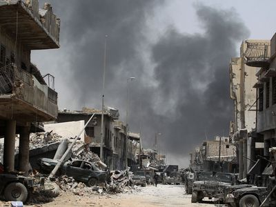 Smoke currently hangs over the Old City as it is continually rocked by air strikes and artillery salvos aimed at the remaining insurgents. (AFP)