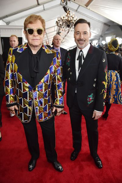 """Singer Elton John and partner David Furnish, both dressed in Gucci arrive at the <a href=""""https://thefix.nine.com.au/2018/01/26/12/31/grammy-awards-2018-winners-nominees-and-live-coverage"""" target=""""_blank"""" title=""""2018 Grammy awards"""">2018 Grammy awards</a>"""