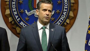 Director of National Intelligence John Ratcliffe speaking at the press conference.