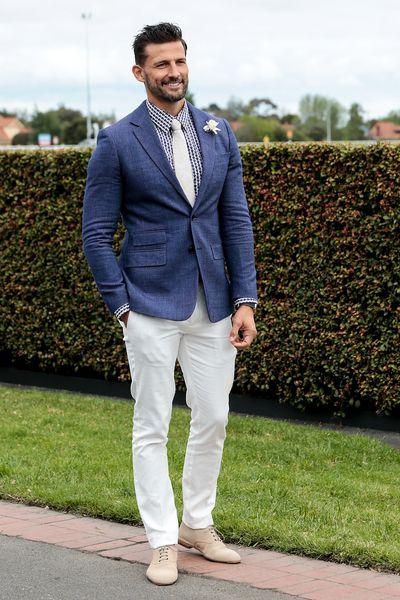 Tim Robards - debonair in cream pants and navy jacket.