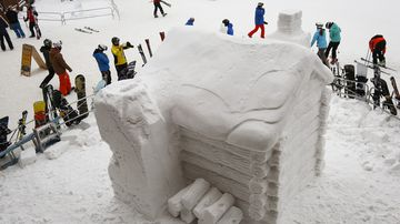 January 21, 2016 - A log cabin carved from ice is displayed as part of the Ice Magic Festival at the Lake Louise ski resort in Canada.(AAP/Jeff McIntosh/The Canadian Press)