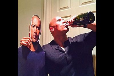 """@therock: """"Happy New Year!! Big love from one handsome son of a b---- and some freak drinking Cristal straight from the bottle. #2014HereWeCome"""""""