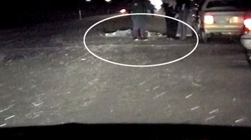 A still taken from police dash cam footage, showing Ricky Hochstetler's dead body on the road.