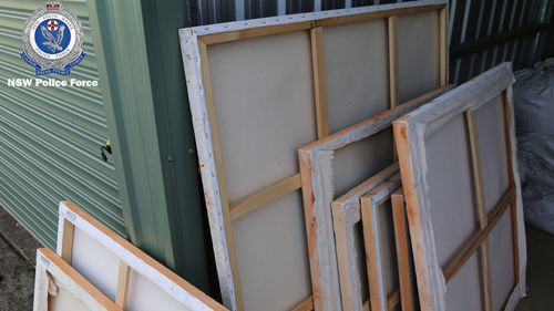 Detectives found and seized several items relevant to the investigation, including paintings.