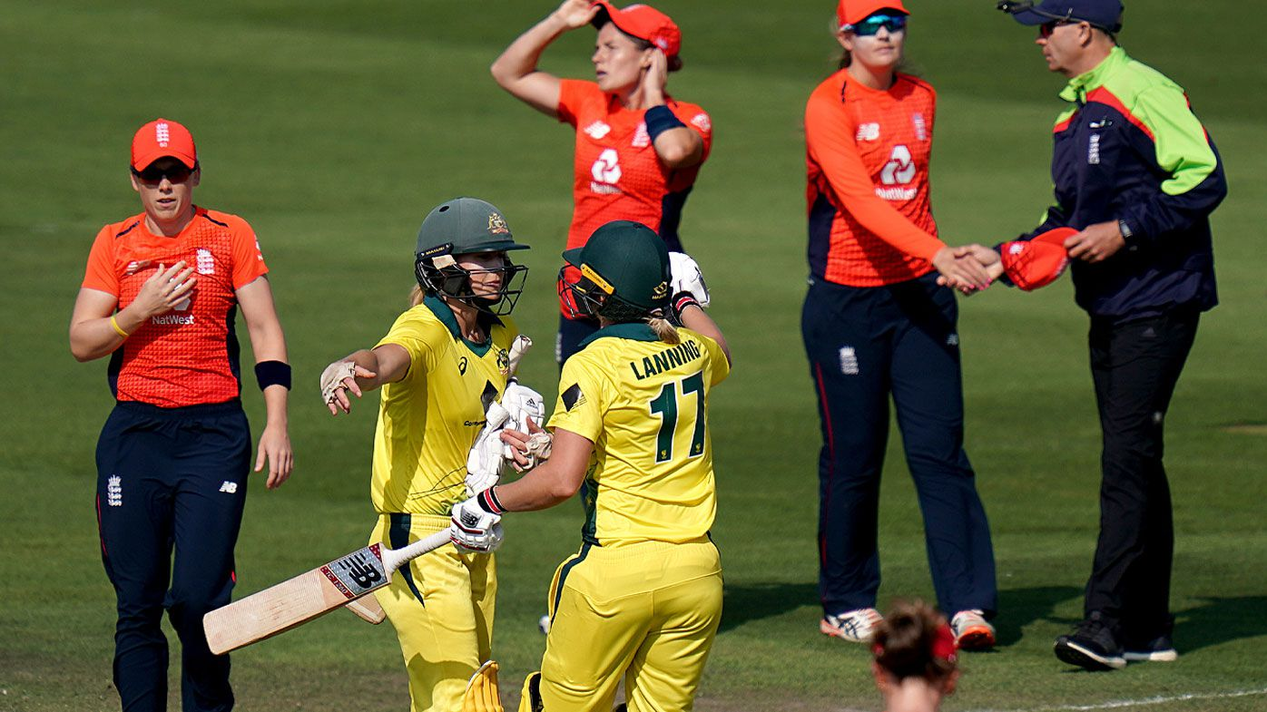 Ellyse Perry celebrates with team-mate Meg Lanning after they defeat England during the third Vitality International T20
