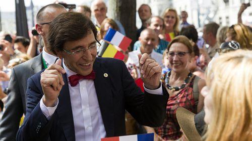 Belgian Prime Minister Elio Di Rupo greets crowds. (AAP)