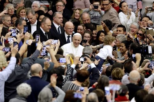 The Pontiff remains a favourite with the faithful on the streets. (AAP)