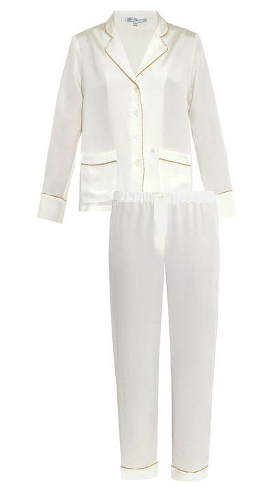 "<p><a href=""http://www.matchesfashion.com/au/products/Rapha%C3%ABlla-Riboud-George-silk-crepe-pyjama-shirt-1007674#"">George Silk-Crepe Pyjama Shirt, $719</a> and <a href=""http://www.matchesfashion.com/au/products/Rapha%C3%ABlla-Riboud-Alfred-silk-crepe-pyjama-trousers-1007675#"">Alfred Silk-Crepe Pyjama Trousers, $442</a>, Raphaëlla Riboud</p>"