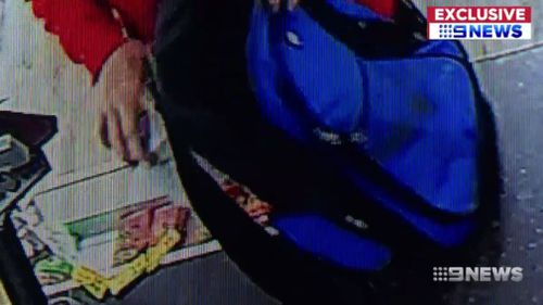 The thief was filmed snatching the charity tin. (9NEWS)