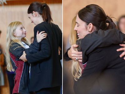 Jacinda Ardern embraces a student at Cashmere High School