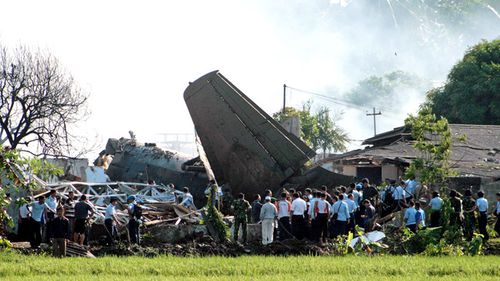 Indonesian rescuers search for victims at the plane crash site near Halim Perdana Kusuma airport in Jakarta on  June 2012. An Indonesian Airforce Fokker 27 plane crashed into eight houses in a neighborhood near the Halim Perdanakusuma Airport. No casualties were confirmed.