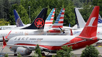 Dozens of grounded Boeing 737 MAX airplanes crowd a parking area adjacent to Boeing Field Thursday, June 27, 2019, in Seattle. A new software problem has been found in the troubled Boeing 737 Max that could push the plane's nose down automatically, and fixing the flaw is almost certain to further delay the plane's return to flying after two deadly crashes.