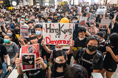 August 12: Protesters occupy the arrival hall of the Hong Kong International Airport during a demonstration.