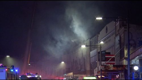 Upon arrival, they saw smoke and flames coming from the back side of the building.