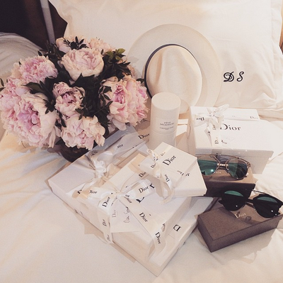 <p>Guests were greeted by a Dior gift bag and posy of peonies.</p>