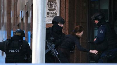 A hostage escapes the Sydney CBD cafe under siege. (AAP)