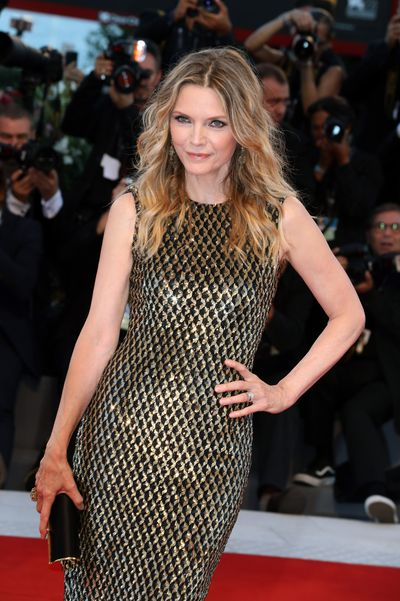 """<p>Michelle Pfeiffer, 59, took Bruno Mars' lyrics to <em>Uptown Funk</em> to heart for her red carpet return alongside Jennifer Lawrence at the Venice Film Festival.</p> <p>The star of <em>Grease 2, Scarface, Dangerous Liaisons</em> and the upcoming <em>Mother&nbsp;</em>dazzled in a golden gown from US designer Michael Kors with a Tods clutch.</p> <p>While the lyric """"Michelle Pfeiffer, that white gold,"""" might have inspired her metallic moment on the red carpet, the accomplished actress and mother-of-two has mixed feelings about the song.</p> <p>""""I was really shocked and bewildered and kind of flattered,"""" Pfeiffer told <a href=""""http://wcbsfm.cbslocal.com/2017/05/18/michelle-pfeiffer-on-hearing-her-name-in-bruno-mars-uptown-funk/"""" target=""""_blank"""">CBS FM</a>'s Brad Blanks in May. """"Wow, that's cool. But sometimes I'm in an exercise class and I'm kind of embarrassed!""""</p> <p>Pfeiffer wasn't the only style standout on in Venice, with co-star Lawrece exquisite in Christian Dior haute couture and British theatre royalty Rebecca Hall sleek in Armani.</p> <p>See the red carpet winners (and losers, sorry Diane Kruger but what were you thinking?) here.</p> <p>&nbsp;</p>"""