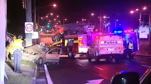 Woman critical after car slams into pole on the Gold Coast