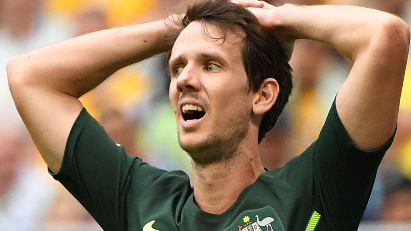 Socceroos rally behind under-fire winger Robbie Kruse following vile social media abuse
