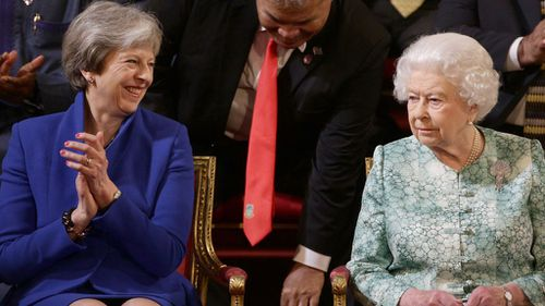 UK Prime Minister Theresa May and the Queen. (AAP)