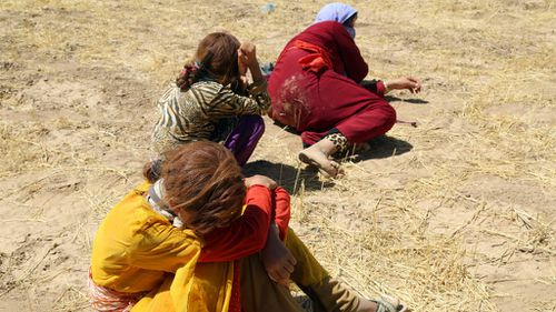 Thousands of Yezidis were trapped in the Sinjar mountains as they tried to escape from Islamic State (IS) forces. (Getty Images)
