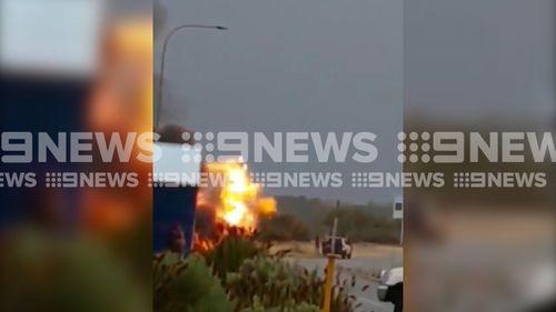 Drivers filmed the moment the caravan caught fire. (9NEWS)