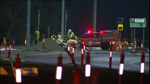 The rider of the motorcycle is believed to have run into the back of the truck. Image: 9News
