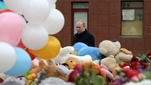 Russian President Vladimir Putin visits a memorial to the fire victims. (AP).