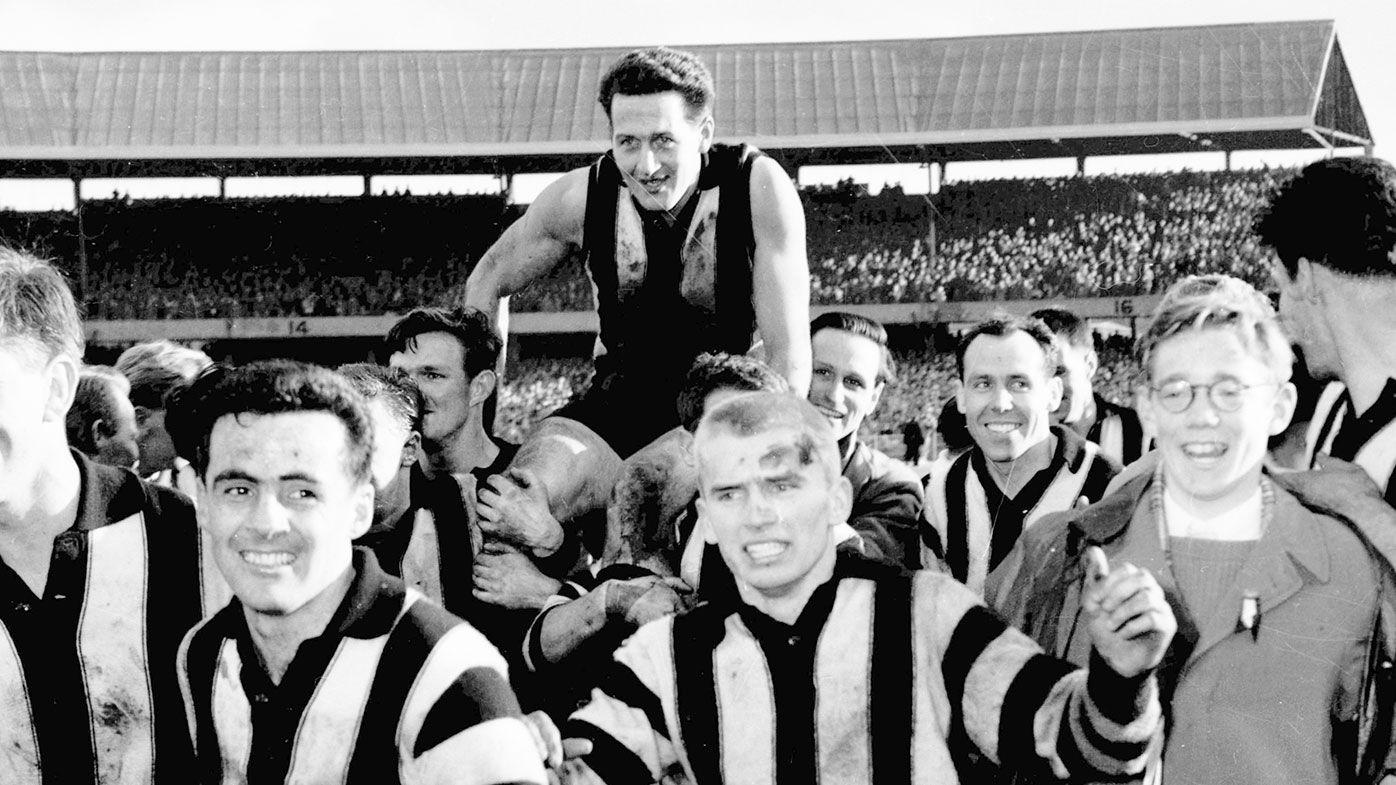 VFL Grand Final, 1958. Melbourne v Collingwood, MCG, 20-09-1958: Collingwood defeated Melbourne 12.10 to 9.10. Collingwood players carry active captain Murray Weideman off the field