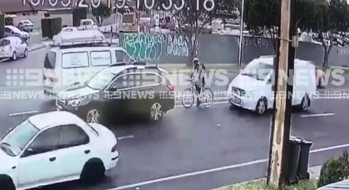 As the cyclist pulled to a stop behind another car at the lights, a white approached behind the rider.