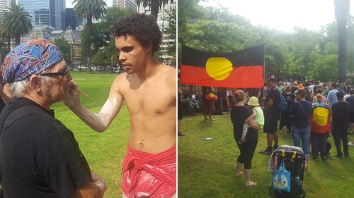 Protesters in Sydney painted their faces in traditional patterns and held up Indigenous flags in a march from Redfern (Supplied).