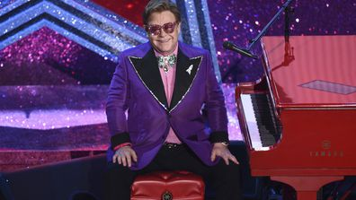 """In this Sunday, Feb. 9, 2020, file photo, Elton John appears after performing his nominated song, """"(I'm Gonna) Love Me Again,"""" at the Oscars in Los Angeles."""