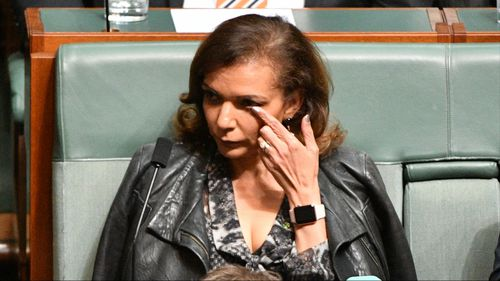 Labor MP Anne Aly wipes away tears.