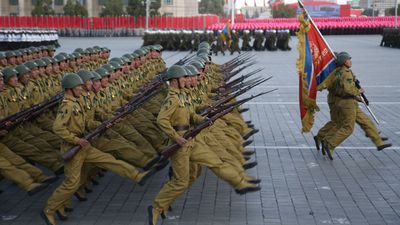 The ceremony, one of the largest displays of military muscle the country had ever organised, saw tens of thousands of troops goose-step their way through Pyongyang's Kim Il-Sung Square, followed by waves of tanks, armoured vehicles and ballistic missiles. (AAP)
