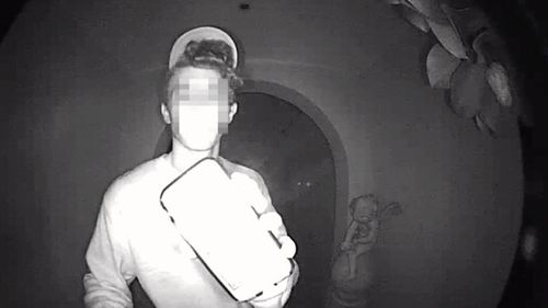 This late night intruder was caught trying to break into a home.
