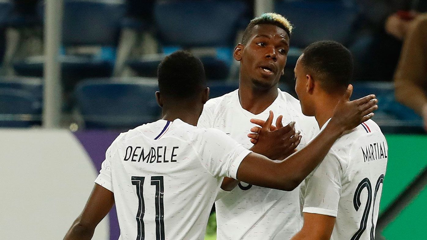Paul Pogba of France celebrates with team mates after scoring
