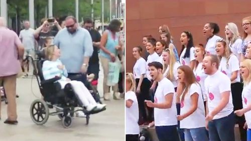 A woman suffering from multiple schlerosis was reduced to tears after her husband surprised her with a flash mob performance for their 10th wedding anniversary. (Facebook/Love Matters/Liverpool Media Academy