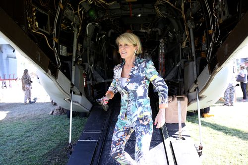 Ms Bishop walks down the back ramp of a US Marine Corp V22 Osprey at the Larrakeyah Barracks. Picture: AAP