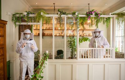This London bar is dressing staff as beekeepers amid pandemic