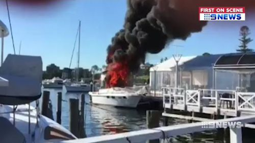 A boat exploded into flames today next to the Lake Macquarie Yacht Club, north of Sydney. Picture: Supplied.