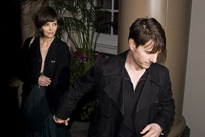 """Hand-holding soon led to the old """"Tom Cruise dragging his bride around"""" thing."""