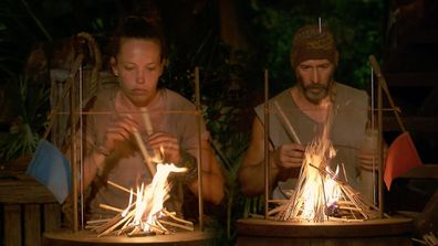 Sarah Lucina and Tony Vlachos in the final fire-making challenge as seen on Survivor: Winners At War in 2020.
