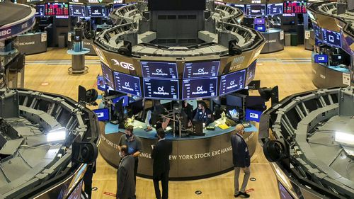 New York Stock Exchange, traders work on the floor during the MediaAlpha IPO, Wednesday Oct. 28, 2020