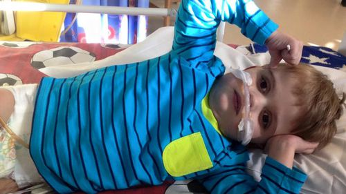 Roman's new heart is too big for him and is pressing on his lungs, so he has to use a breathing machine. (Facebook)