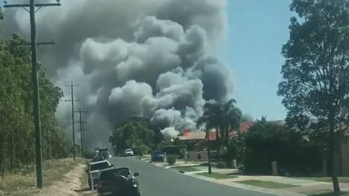 Man and child injured in Brisbane house fire