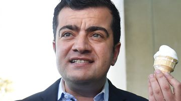 """The Facebook account for the Liberal Party of Ryde has posted an attack on Senator Sam Dastyari, referring to his smile as a """"s--- eating grin"""". (AAP)"""